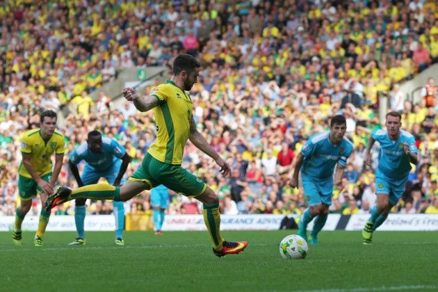 Catch us if you can, is the challenge for the rest of the Championship after Norwich City powered to top spot following a fourth consecutive league win against Burton Albion.
