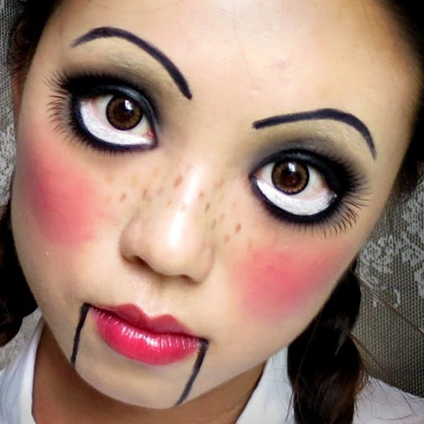 Doll Make-up - Simple doll make-up. This recreates a puppet type of doll due to the parallel lines on the jaw. It incorporates large eyes, thing brows, rosy cheeks and freckles.