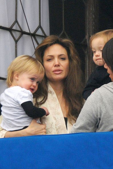 Mom of a million babies Angelina Jolie can't be made up all the time—even if she is on a glamourous set in Venice. Here, Angie steps out on her hotel balcony to see about a crying babe and met the paparrazi with a clean face and tired eyes. Even sleepy, Angie's still got it.
