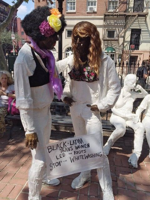 Activists paint a Stonewall Riots memorial to reflect the leadership and activism of trans women of color, recently whitewashed out of the Stonewall film.