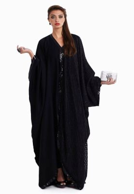 Make a glamorous style statement with this gorgeous Abaya at your next social event! Features an asymmetrical design with luxurious gold sequins detailing and loose draped butterfly design. Slip into this beautiful Abaya and step out feeling like royalty!