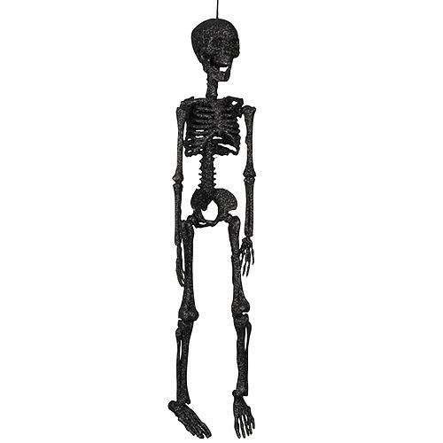 Un decorado siniestro pero con destello! Siéntale en la barra, cuélgale del techo, llévale como parte de tu disfraz... Nuestro esqueleto negro purpurina, de www.fiestafacil.com.