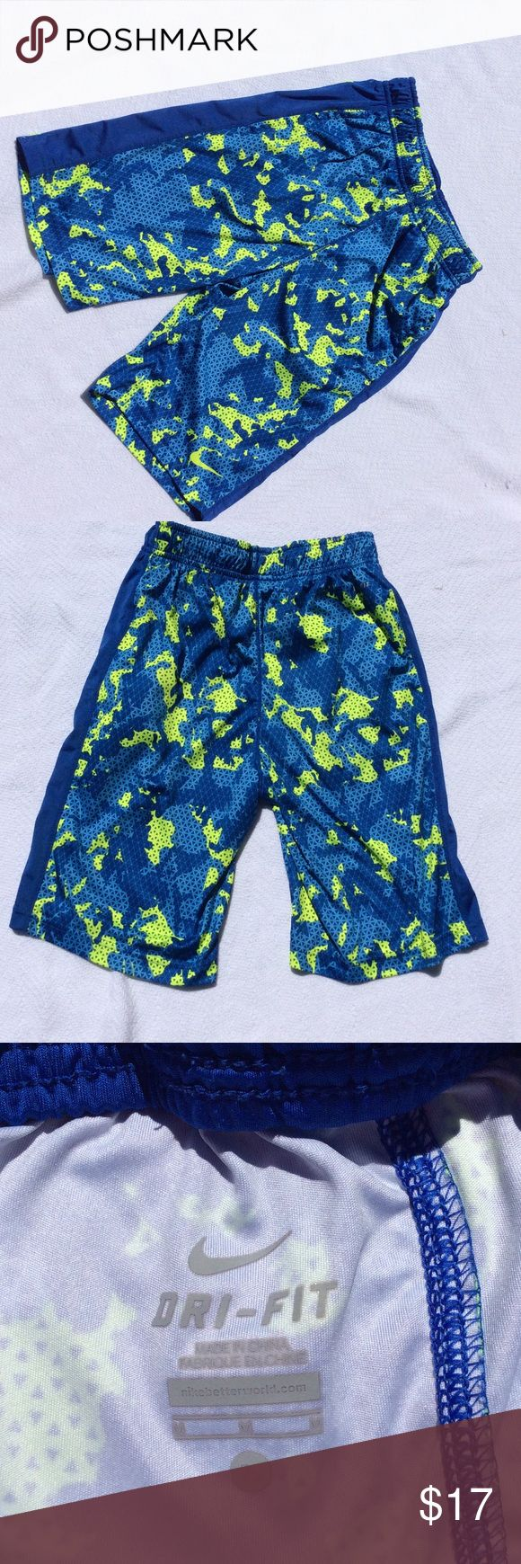 Boys Size M Nike Shorts Worn twice boys Nike shorts in a blue and yellow pattern. Has a solid blue stripe up he sides. Excellent condition! Nike Bottoms Shorts