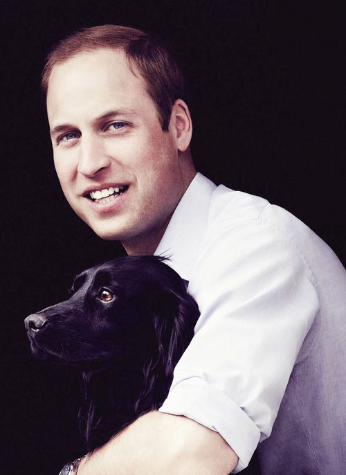 HRH The Duke of Cambridge with the royal family's dog Lupo