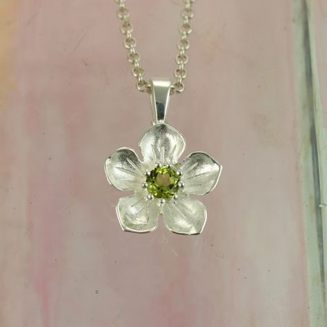Peridot Posy Pendant £32.00 For those of you who have a thing for green...sparkling peridot set in a sterling silver flower pendant All of our silver jewellery comes beautifully packaged in our new Christin Ranger branded boxes.