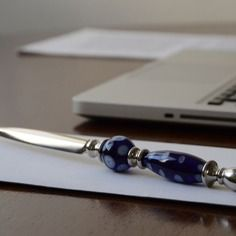 Tagliacarte impreziosito con perle in vetro di murano