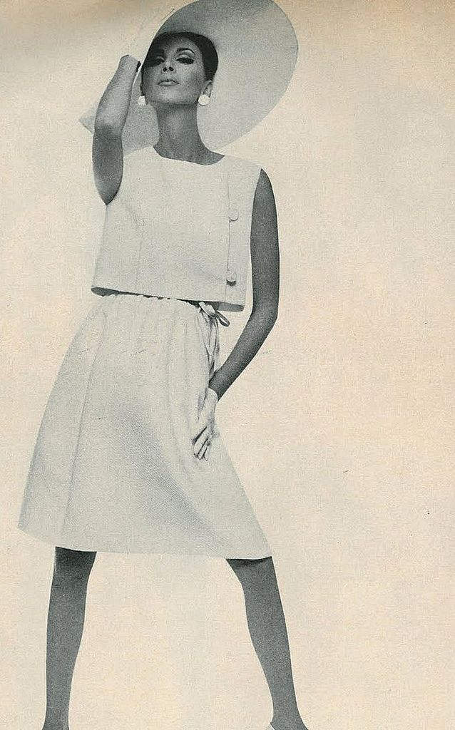 Wilhelmina in a side-buttoned sleeveless jacket over a white pique dress by Teal-Traina, photo by Bert Stern for Vogue 1965
