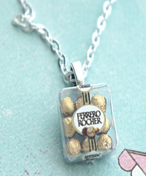 This necklace features a miniature box pendant of handmade ferrero rocher chocolates sculpted from polymer clay. Each chocolate is individually wrapped with gold foil for a realistic appeal. The penda
