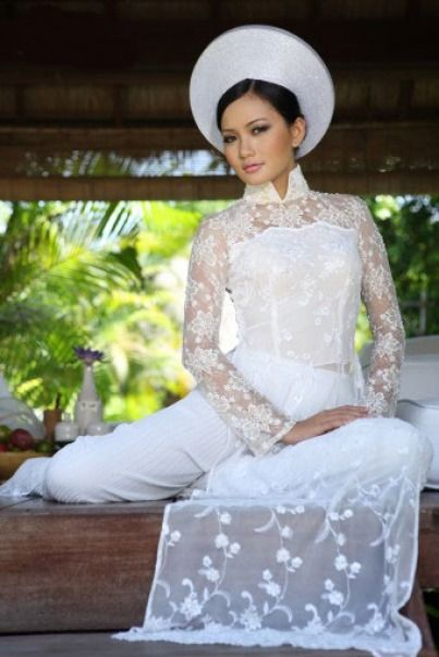 Modern Bridal White Ao Dai for Tea Ceremony and Receiving Red Envelopes.