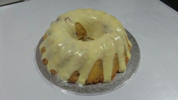 Lemon raspberry cream cheese pound cake dribbling lemon icing n glitter baked by MJ Hawkes Bay NZ www.mjscakes.co.nz