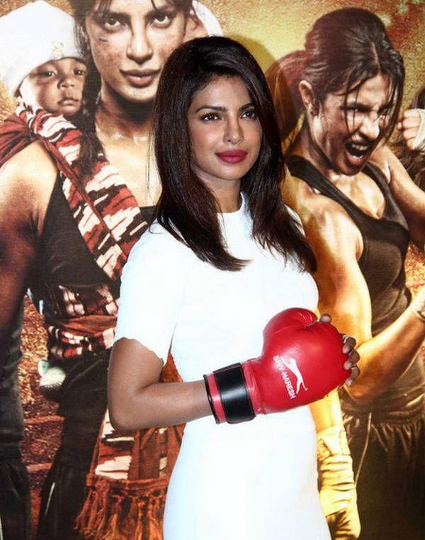 Priyanka Chopra in white dress at MARY KOM film Premier as the boxer in her latest film