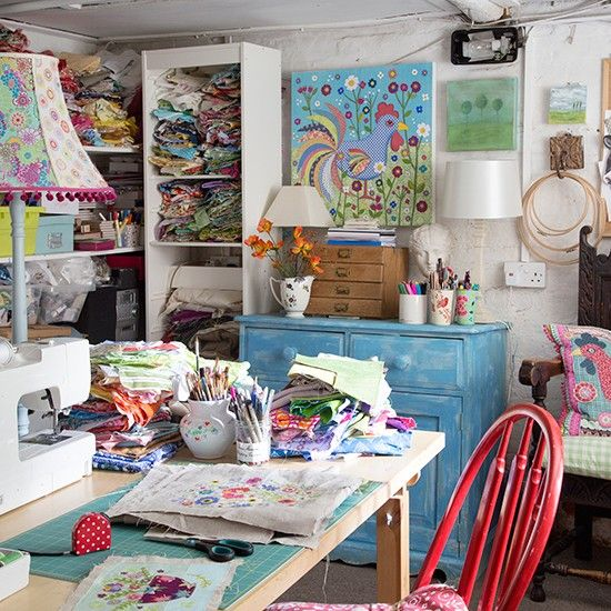 Home office. This craft room, formally a beer cellar, makes use of every inch of its space. The owner uses it to house her collection of off cut fabrics for her many textile projects. Storage is squeezed into every nook and cranny, with floor-to-ceiling shelves, a mini distressed sideboard with desktop drawer unit. Similar chair, Wayfair, Similar sidebrd, Maisons du Monde.