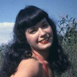 bettie page.     (sadly, my hair will *never* do this.)