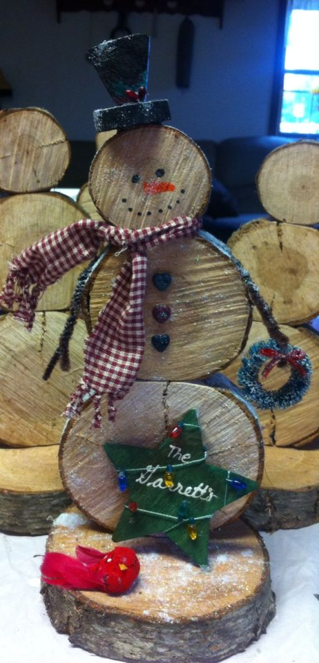 Country snowman made from oak logs