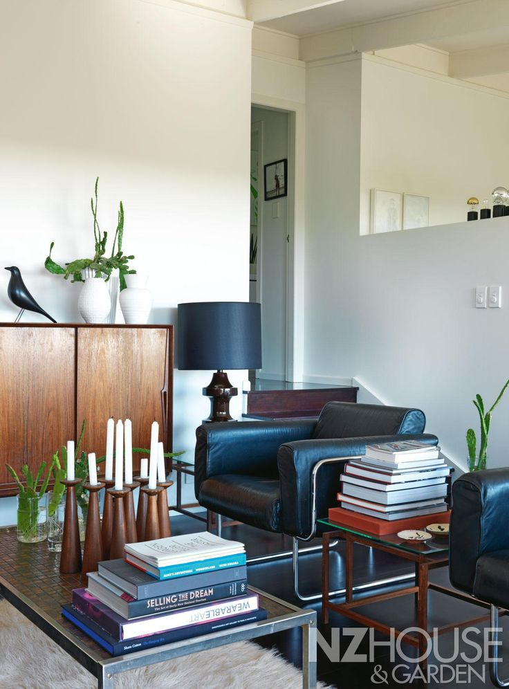 An Eames house bird sits on a mid-century rosewood sideboard, flanked by a pair of leather and chrome Scandinavian armchairs; the wooden candleholders are from Martin's Wellington shop, Brown & Co, and sit atop a 1970s tile and chrome coffee table sourced, like most of his mid-century pieces, by his good friends Ross Morrison and Monica Beaumont of Christchurch's Mr Mod. - See more at: http://nzhouseandgarden.co.nz/soul-soother/#sthash.FOlndXmh.dpuf