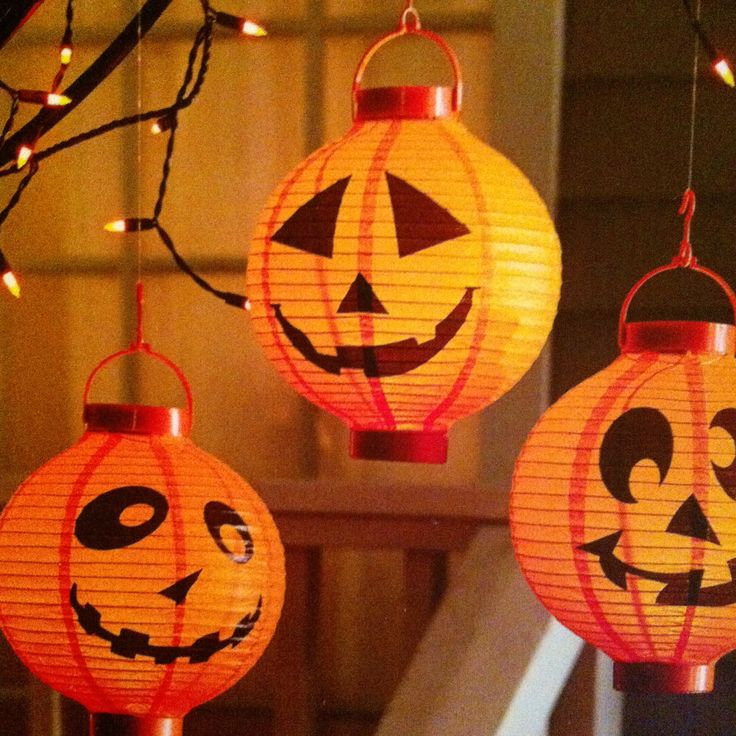 Hang these from fishing line in a covered porch or inside the front door.  Battery operated paper pumpkin lanterns from #Pier1Imports
