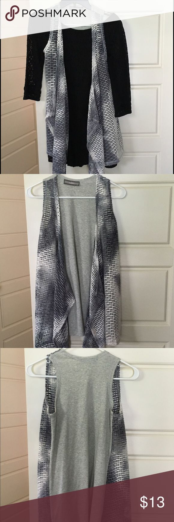 Multi color Vest Unique grey and white dress. Can be worn to dress up a nice outfit (pic 1) or casually with a cotton shirt (pic 4). No signs of damage or wear. Great layering piece for the fall and winter! Jackets & Coats Vests