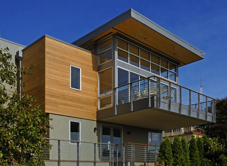 cedar tongue groove siding warms up a home constructed with a large amount of metal
