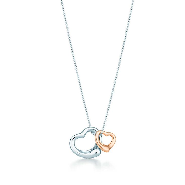Raf will buy this for Meredith and Zoe.  Elsa Peretti® Open Heart pendant in sterling silver and 18k rose gold, small. | Tiffany & Co.