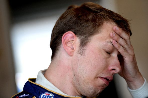 Brad Keselowski Photos - Brad Keselowski, driver of the #2 Miller Lite Ford, looks on during practice for the NASCAR Sprint Cup Series Samuel Deeds 400 At The Brickyard at Indianapolis Motor Speedway on July 26, 2013 in Indianapolis, Indiana. - Indianapolis Motor Speedway: Day 2