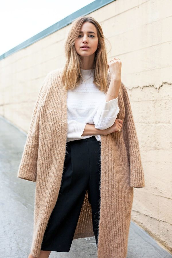 Camel sweater, white top, and cropped black pants