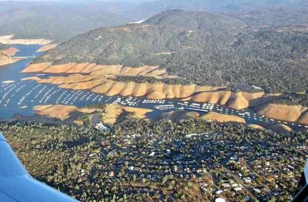 """Lots of brown: Lake Oroville has a wide brown rim these days as the water level has been drawn down farther than usual to allow room for storm runoff. Although the Department of Water Resources says the main spillway has been repaired enough to handle flows of 100,000 cubic feet per second, it would rather not use it this winter. Readers can submit photos for consideration to """"Hot Shot"""" at photo@chicoer.com or tag their photos with #thisischico on Instagram. November 2017"""