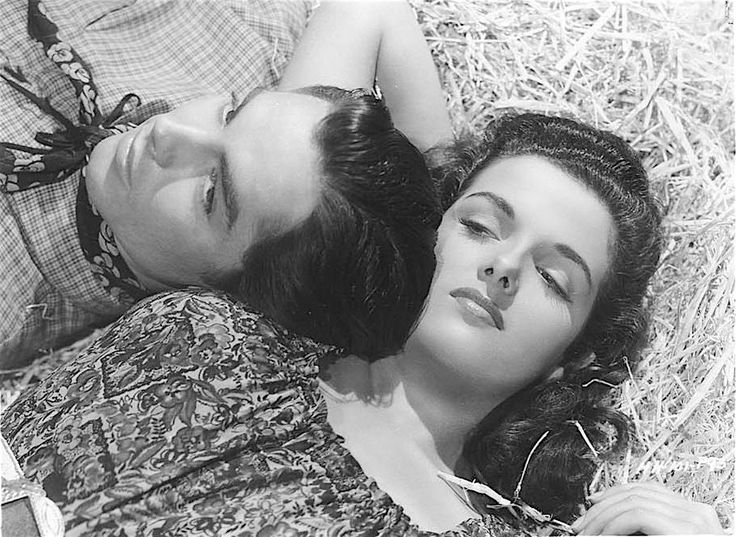 A Jane Russell and Jack Beutel publicity photo for Howard Hughes' THE OUTLAW (1943).