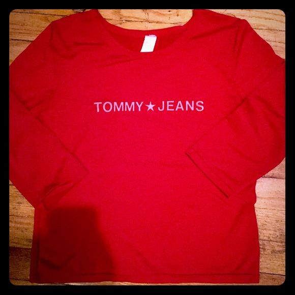 TOMMY top❤️ Very stylish and cute, red shirt( perfect color for vday)! 19inches long ,size medium, sleeve l is 14 inches, I can honestly say  I don't remember wearing this often, But I do remember getting in a tommy outlet, It's in awesome condition! Deff ready for a new home! Stylish and comfy, can't go won't! Questions welcome! Take advantage of my sale! 💕Happy poshing!! Tommy Hilfiger Tops