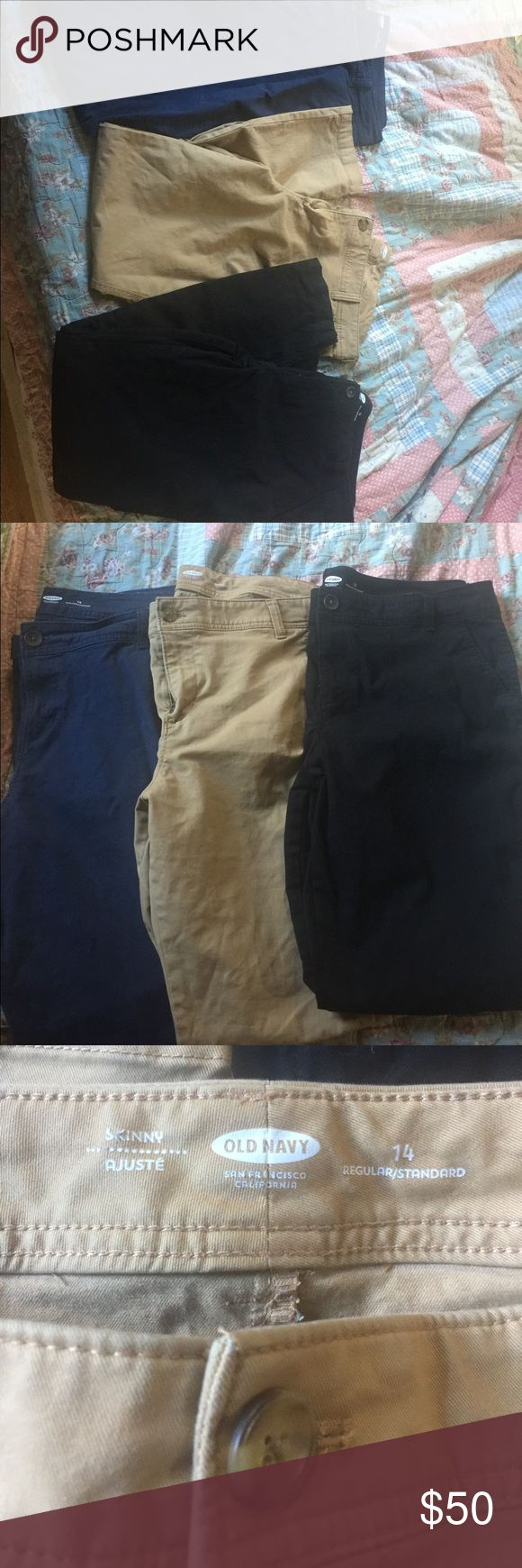 Old navy work pants I've 14 regular length all only worn about once due to me losing weight. The navy pair is boot cut & the black & khaki pair are skinny. These retail for $25 each pair. Feel free to make offers! Old Navy Pants Skinny