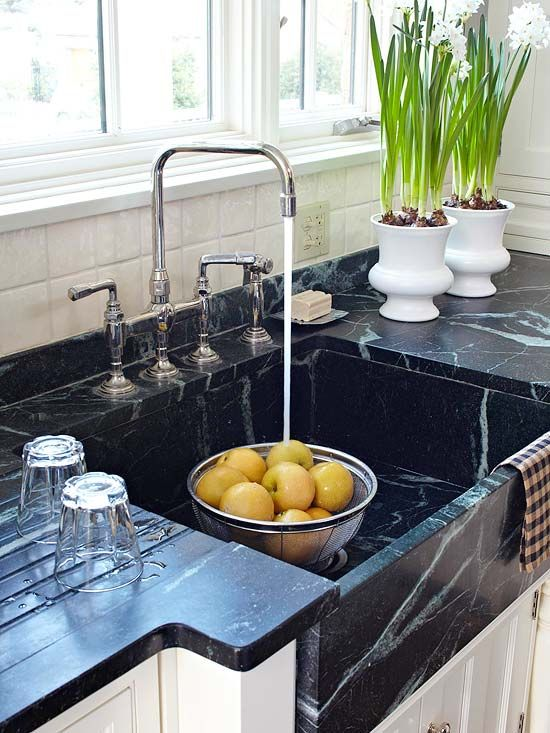 love the deep apron-front sink.. plus off to the side the carved ridges in the counter top serve as a  built in drying rack! love it