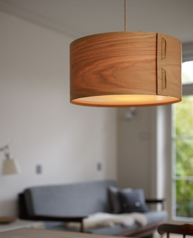 Tab lampshade by John Green. the warm glow given by the oak veneer is perfect for adding the right ambience for Hygge this winter. Add modern Scandinavian see to your home with stylish unique lighting, designed and made in the UK by award winning designer
