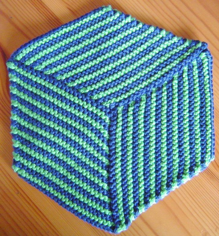 Free Knitting Pattern for Optical Illusion Cloth - Inspired by the traditional Tumbling Blocks quilt pattern, this pattern creates a cloth or potholder that looks like a 3D cube. Designed by Barbara Breiter. Pictured project by Imara. Gauge is very important to make sure the paralleograms create the right shape.