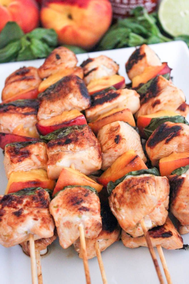 Sriracha Glazed Chicken Skewers with Peaches and Basil. Love these easy skewers for summer entertaining!