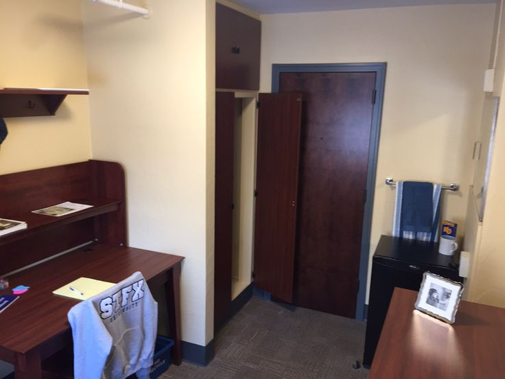 Newly renovated MSB with views of dresser, desk, chair, mini-fridge, towel rack, mirror, and closet.