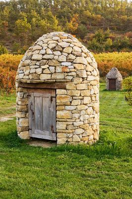 Stone well house in the vineyards, Domaine de la Verriere, France│ Clive Nichols
