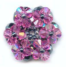Pink Swarovski ring  MATERIALS  50 swarovski crystals 4 mm round, hematite color  50 swarovski bicone 4 mm Rose AB   10 g color hematite beadssize ? 10? 11? delica   transparent nylon thread 0.25 mm