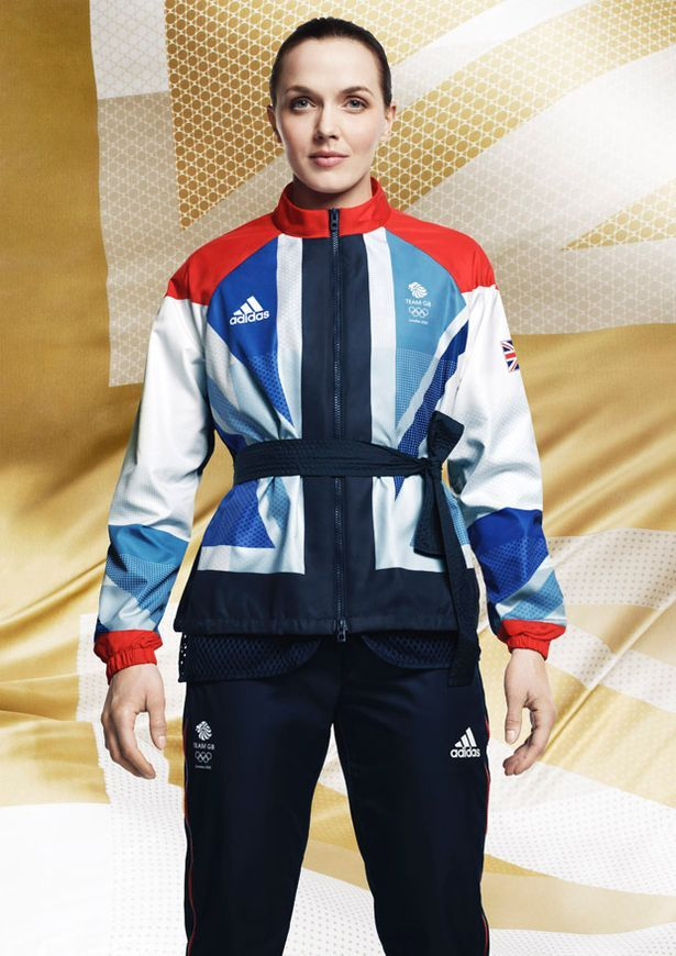 Judo time? Cyclist Victoria Pendleton shows off the Team GB warm-up suit - complete with tied belt