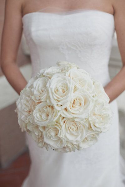 Simple white rose bridal bouquet, id like it with red/yellow/ or pink with white mixed in =]