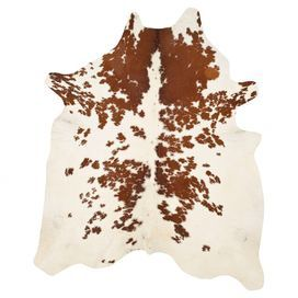 cowhide rug in brown and white.