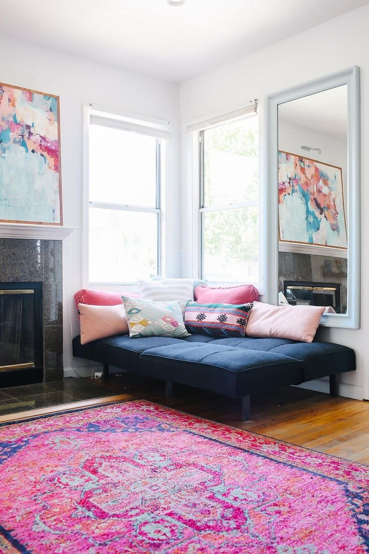Corner chaise with pillows via Apartment Therapy