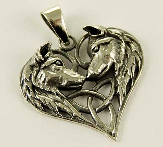 wolf heart sterling silver pendant with high quality braided leather cord with sterling silver clasp 18 inch on Etsy, £30.00