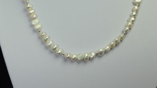 Luna Necklace is a beautiful classic style of white pearls accented with silver balls.