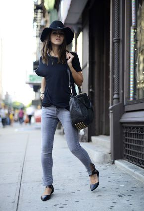 Black top paired with grey jeans and black ballerina pumps.