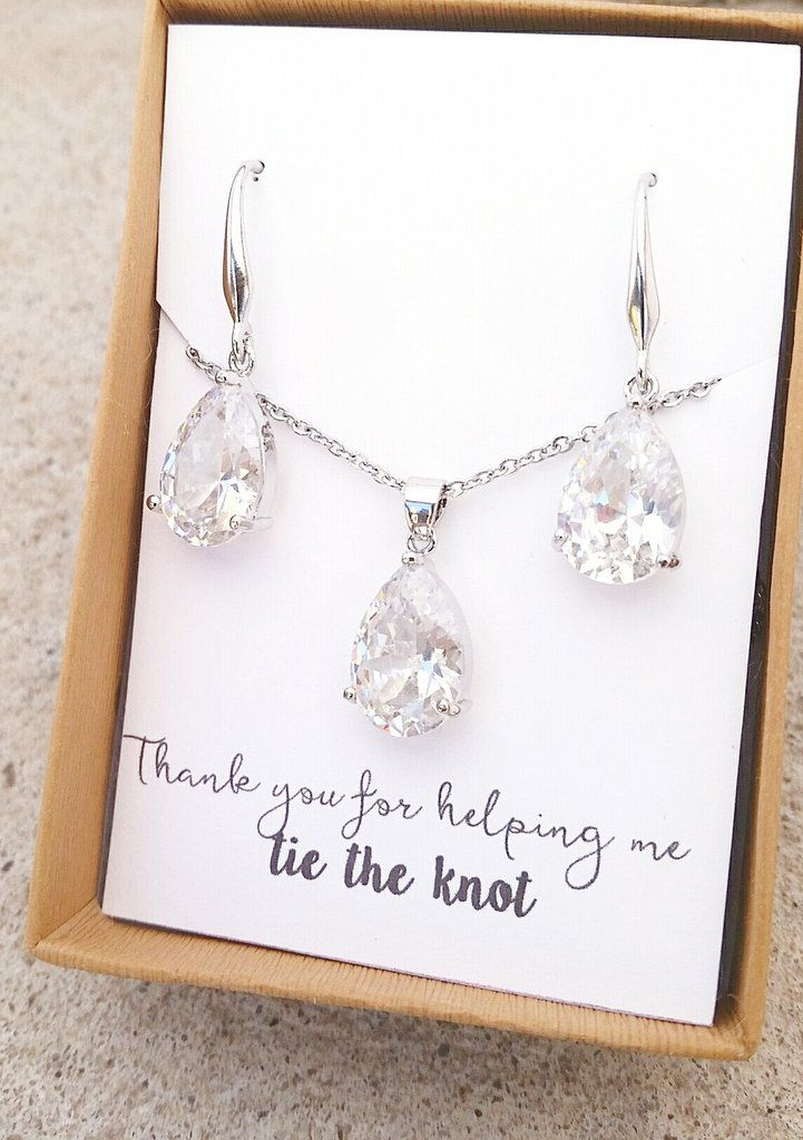 Beautiful sterling silver cubic zirconia necklace and earrings set. The perfect gift for her. Necklace length 17-18 inches. Earring size 18x11 mm. All orders come beautifully gift boxed with ribbon. O