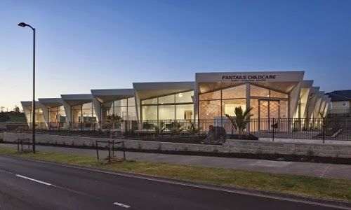 "Fantails Childcare in the new Auckland sub-division of Silverdale does not shy away from the street. Rather it presents a bold ""look at me"" faceted glass facade, like that of the fantail from which it takes its inspiration."
