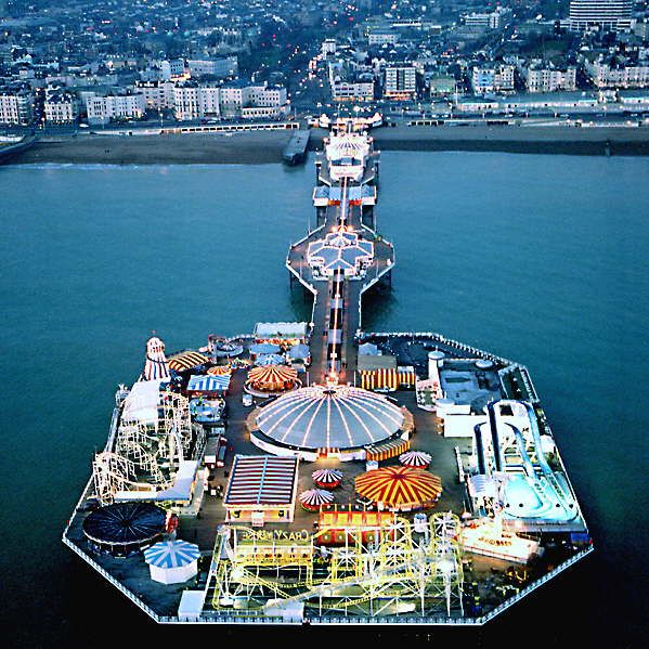 Brighton, UK - Home of Brighton Pier with video games, rides, and restaurants. I had my first fish and chips there. There is a scenic drive along the sea, and the beaches are rock beaches, not sand. In town there is the Royal Pavilion, a former summer home of British Royalty and a copy of an Indian palace.