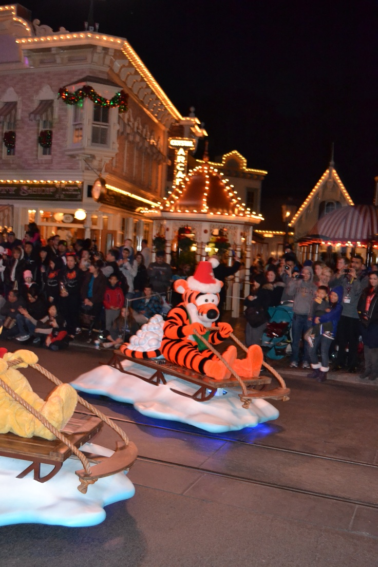 Disneyland s christmas parade 2012 racing in their sleds