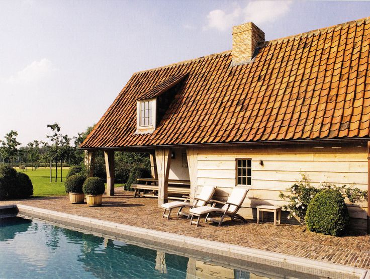Belgium pool house with a low tiled roof