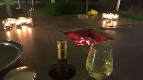 These happy people were having a romantic moment #romantic  #warmevening  #outdoorheater  #gardentable
