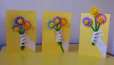Cute Mother's Day card made from child's hand and wrist print, paper flowers and folded construction paper.